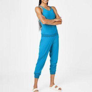 Sweaty Betty Beautify Jumpsuit in Mosaic Blue.